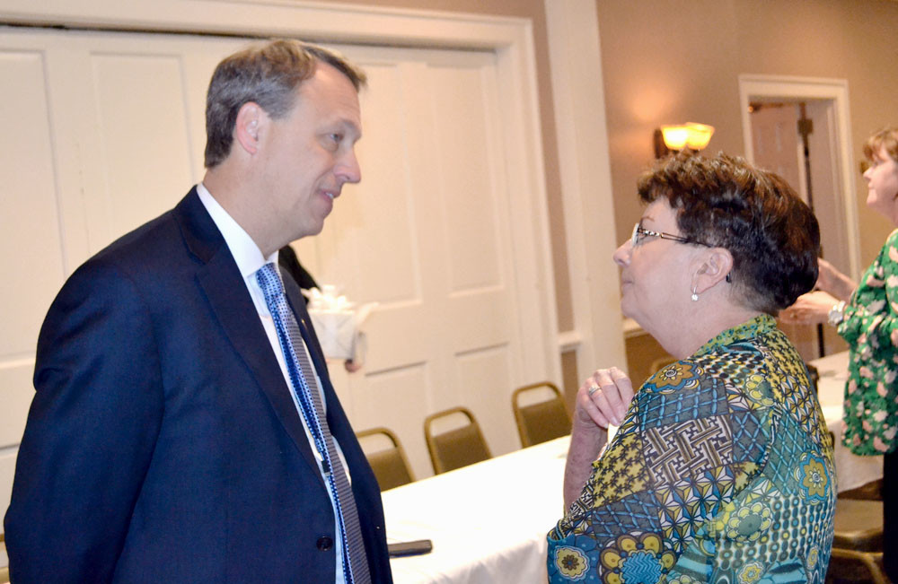 Banner photo, ALLEN MINCEY SUNRISE ROTARY CLUB member Cheryl Dunson, right, speaks to District Attorney General Steve Crump following Thursday's club meeting.