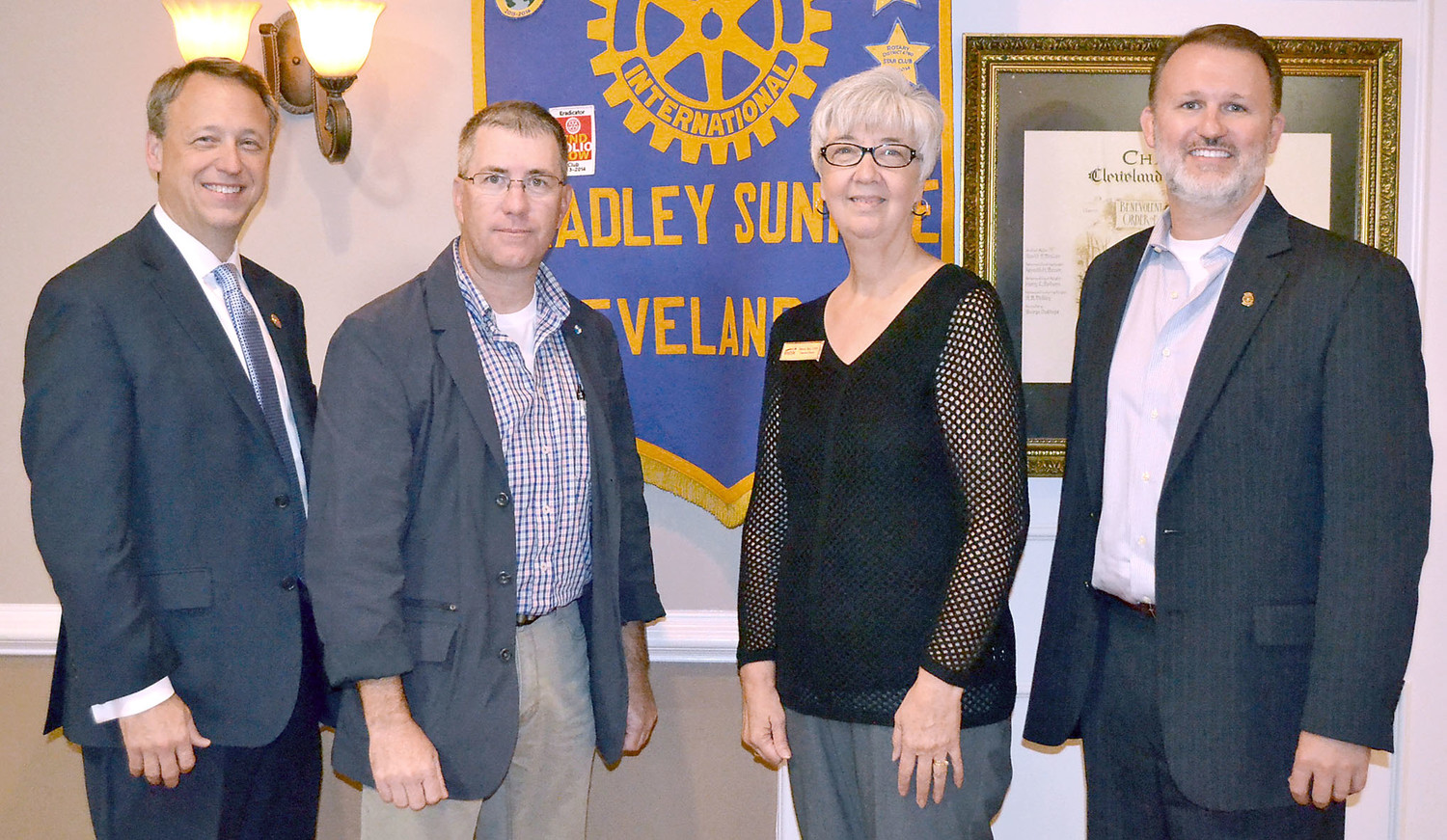 THE BRIDGE and District Attorney General Steve Crump were special guests at Thursday's meeting of the Sunrise Rotary Club. The organization and Crump spoke about the problem of drug overdose. From left are Crump, Scott Elam and Reba Terry of The Bridge, and Sunrise Rotary Club President Matthew Coleman.