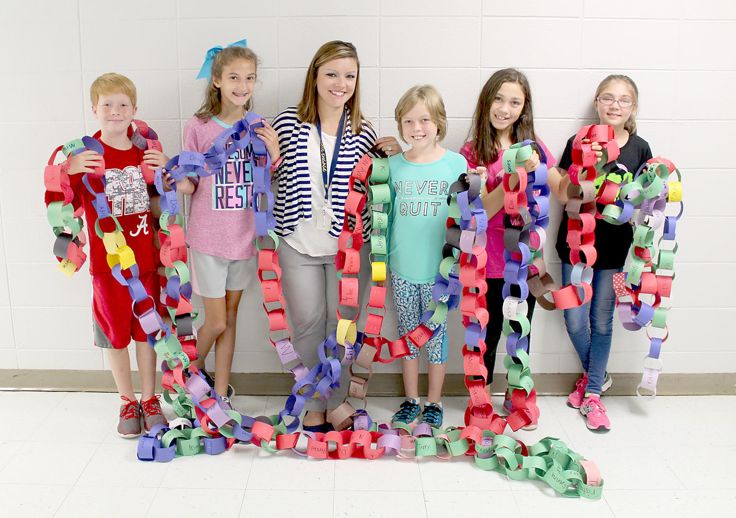 A PAPER CHAIN fundraiser at E.L. Ross Elementary helped raise $2,700 for a school affected by Hurricane Harvey. With teacher Sara Whitener, center, are student Ephraim Kyle, left, and, in no certain order, members of Girl Scout Troop 40949: Ayonna DeLuca, Brooke Jones, Eva Laslie and Deirdre McKelvey. Not pictured are Girl Scouts Caroline Condo, Emmaline Hill and Anna Longest.