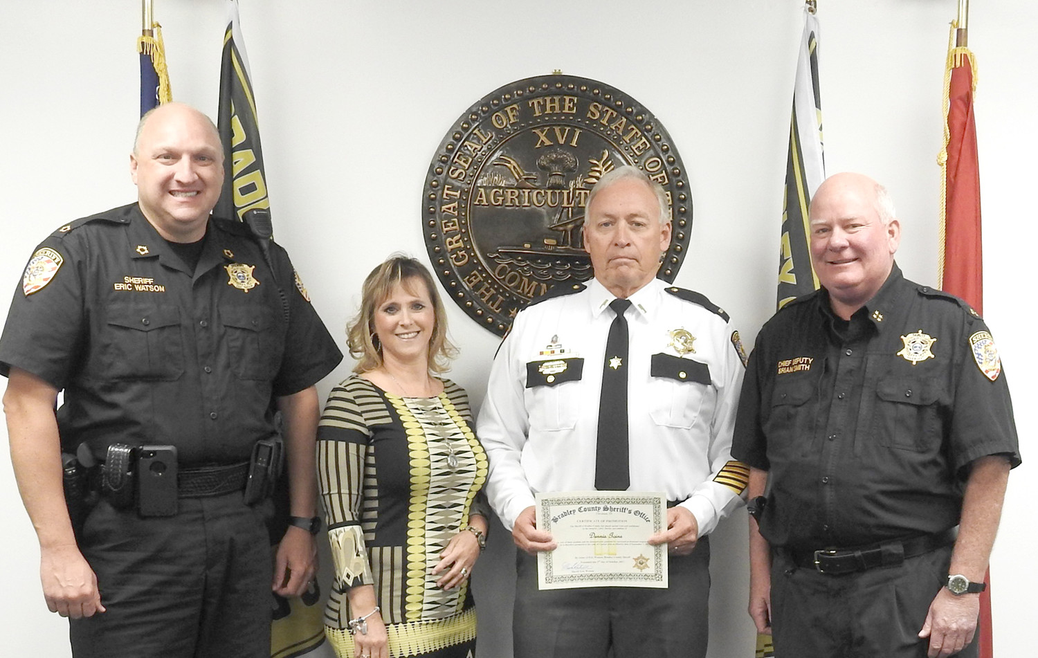 DENNIS GOINS was recently named as captain of the Bradley County Sheriff's Office Patrol Division. From left are Sheriff Eric Watson, Deanna Goins, Goins, and Deputy Chief Brian Smith.