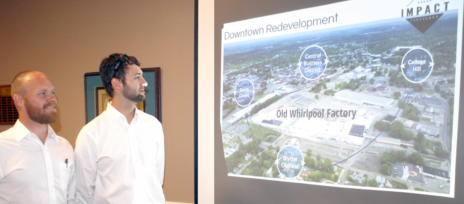 IMPACT'S CLEVELAND'S Dustin Toomey, left, and Kiwanis Club President Mike Stoess view a video of the Downtown Cleveland area and the old Whirlpool property.  Impact Cleveland is working to revitalize the Blythe/Oldfield Neighborhood, just south of the Whirlpool property.