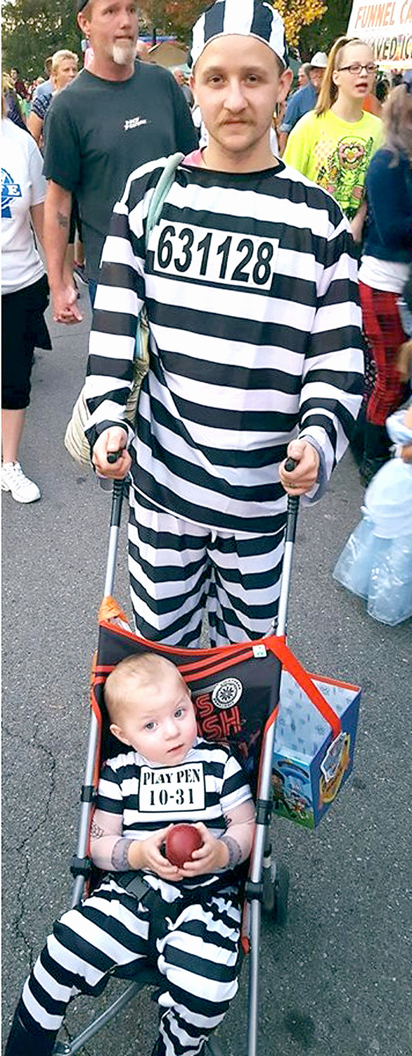 PARENTS AND THEIR KIDS often dress in similar outfits as they enjoy the Halloween Block Party.