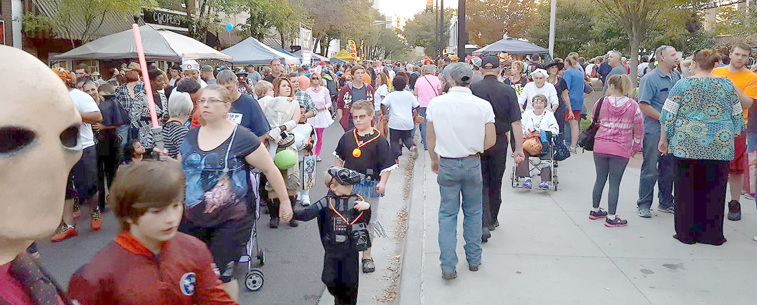 LARGE CROWDS LINE the area around the Bradley County Courthouse at the Halloween Block Party.