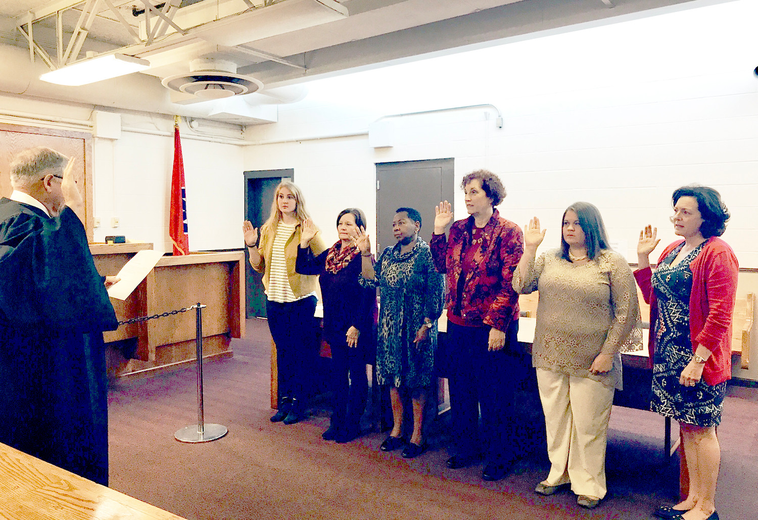 EIGHT NEW ADVOCATES for CASA of Bradley and Polk counties were recently sworn in by Judge Dan Swafford, left. From left are Grace Calfee, Sharon Watkins, Shirley Morgan, Karen Viser, Natalie Barrionuevo and Kim Mitchell. Michelle Quintero and Mackenzie Tatum were unavailable for the photograph..