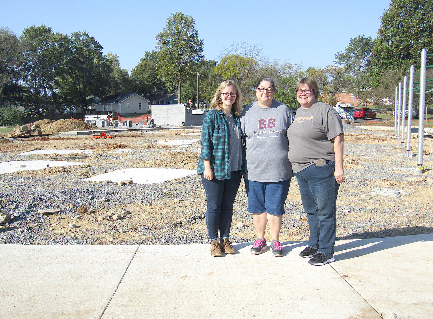 The Blythe-Oldfield Community is anxiously awaiting the completion of its new playground pavilion complex. From left are Melanie Brubaker, an AmeriCorps VISTA with Impact Cleveland; Shirley Knight, treasurer, Blythe-Oldfield Community Association; and Julia Porter, president, Blythe-Oldfield Community Association.