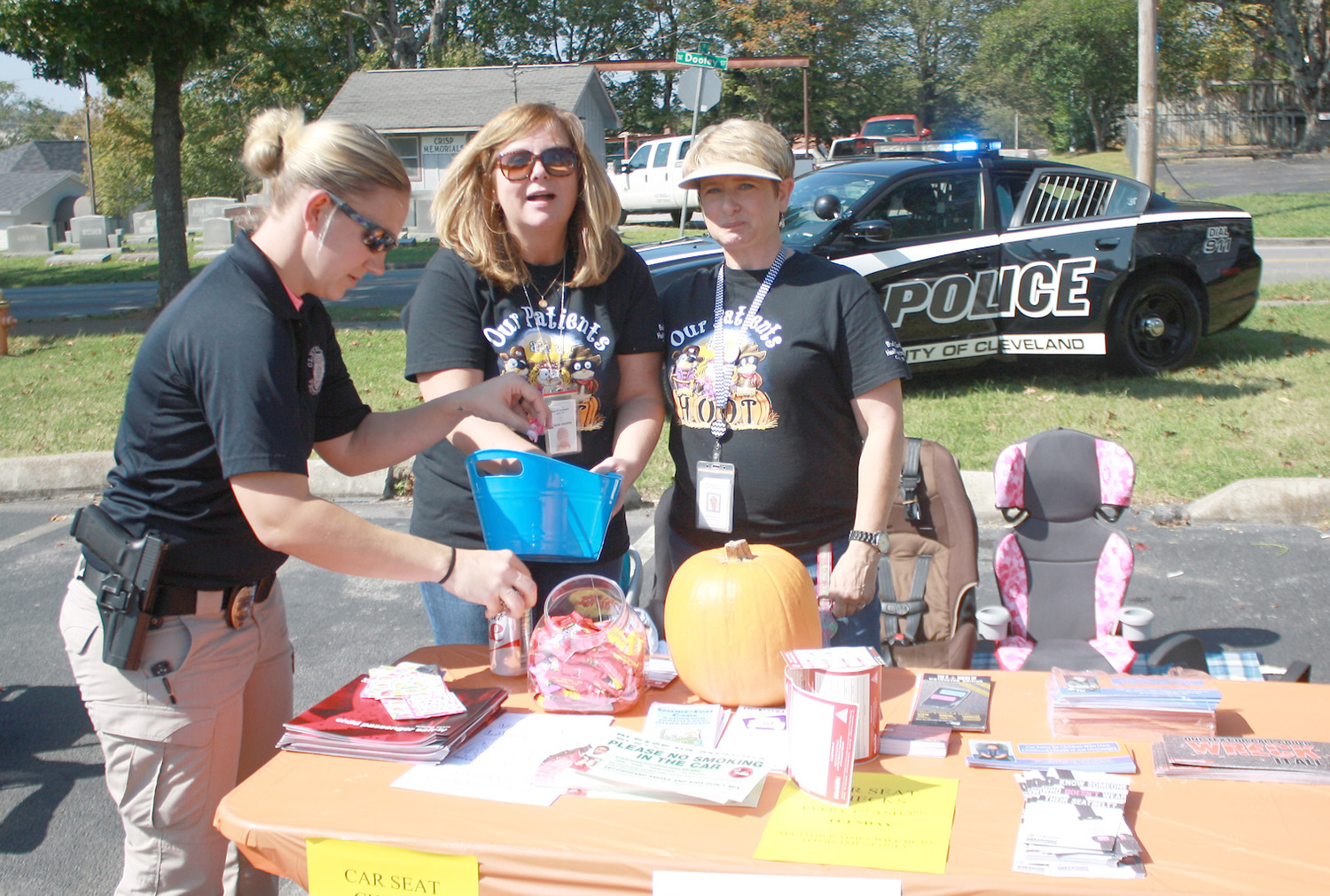 CLEVELAND OFFICER Jennifer Samples, left, joined health department technicians Teresa Rodgers, center, and Tammy Stevison in giving directions for installing child safety seats.