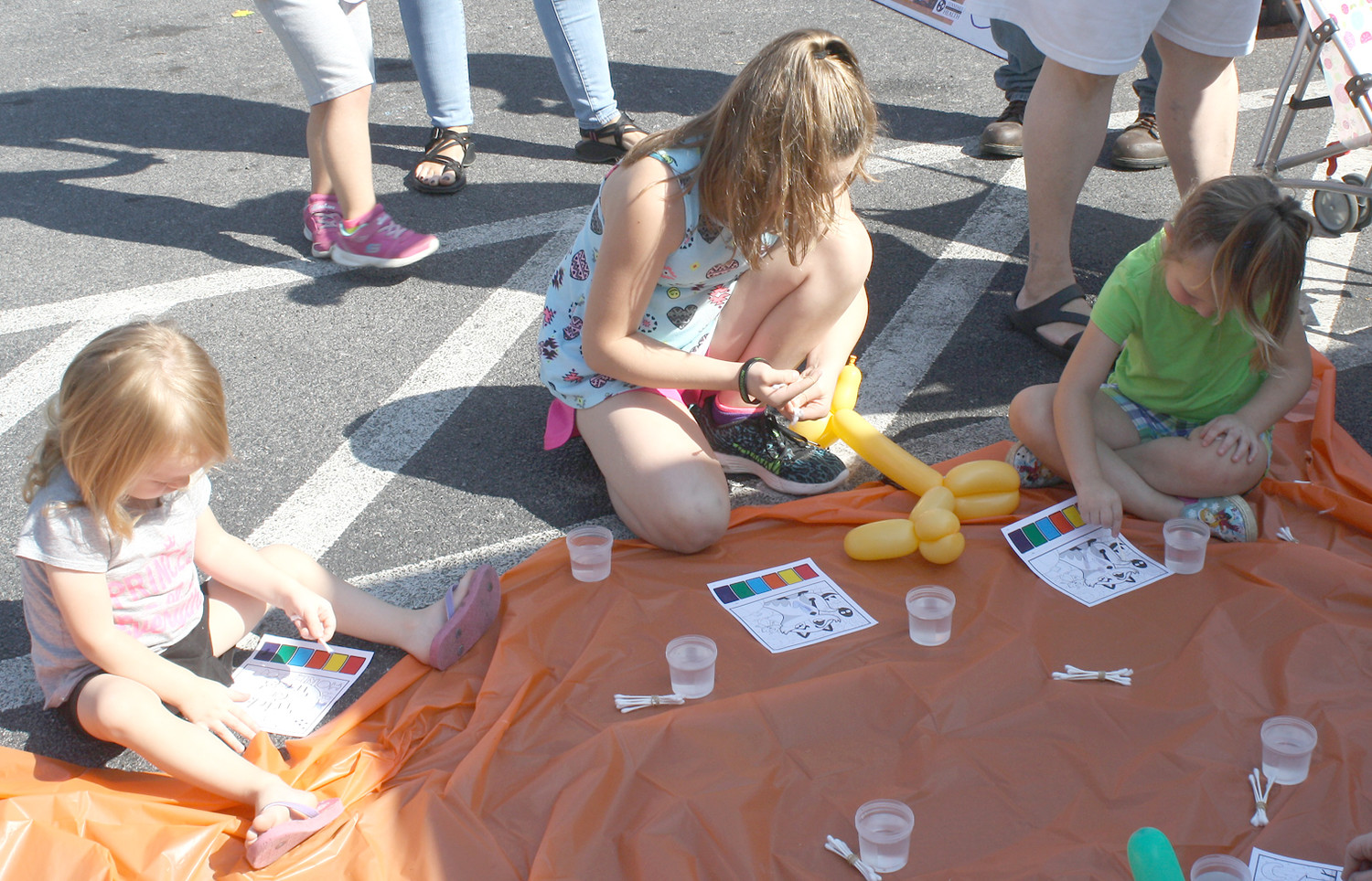 THESE THREE YOUNGSTERS, of varying sizes, were busy with the opportunity to draw and color at Friday's Bradley County Health Department's third annual Fall Festival.