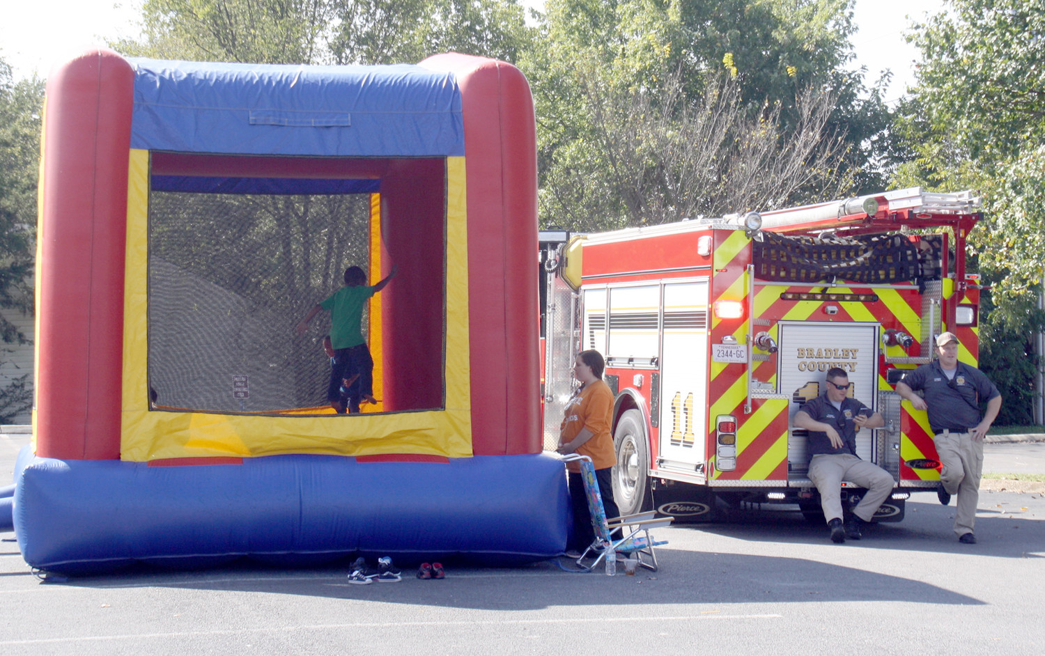 ONE OF THE POPULAR attractions at Friday's health department Fall Festival was the bounce game. As the festival was just getting started Friday, two members of the Cleveland Fire Department were waiting for interested youngsters.