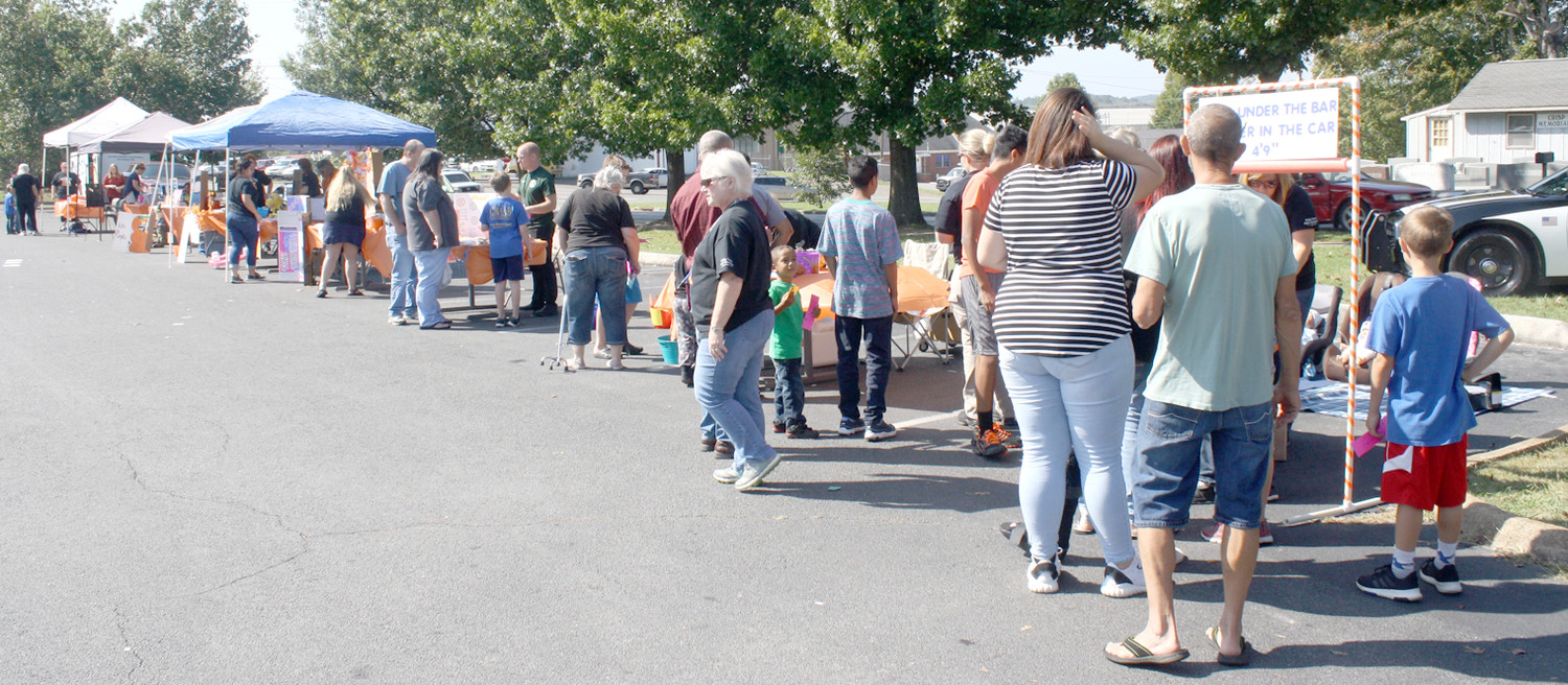VISITORS WERE BEGINNING to mingle through a number of information and activity booths at the Bradley County Health Department's third annual Fall Festival Friday afternoon. More than 300 kids attended.