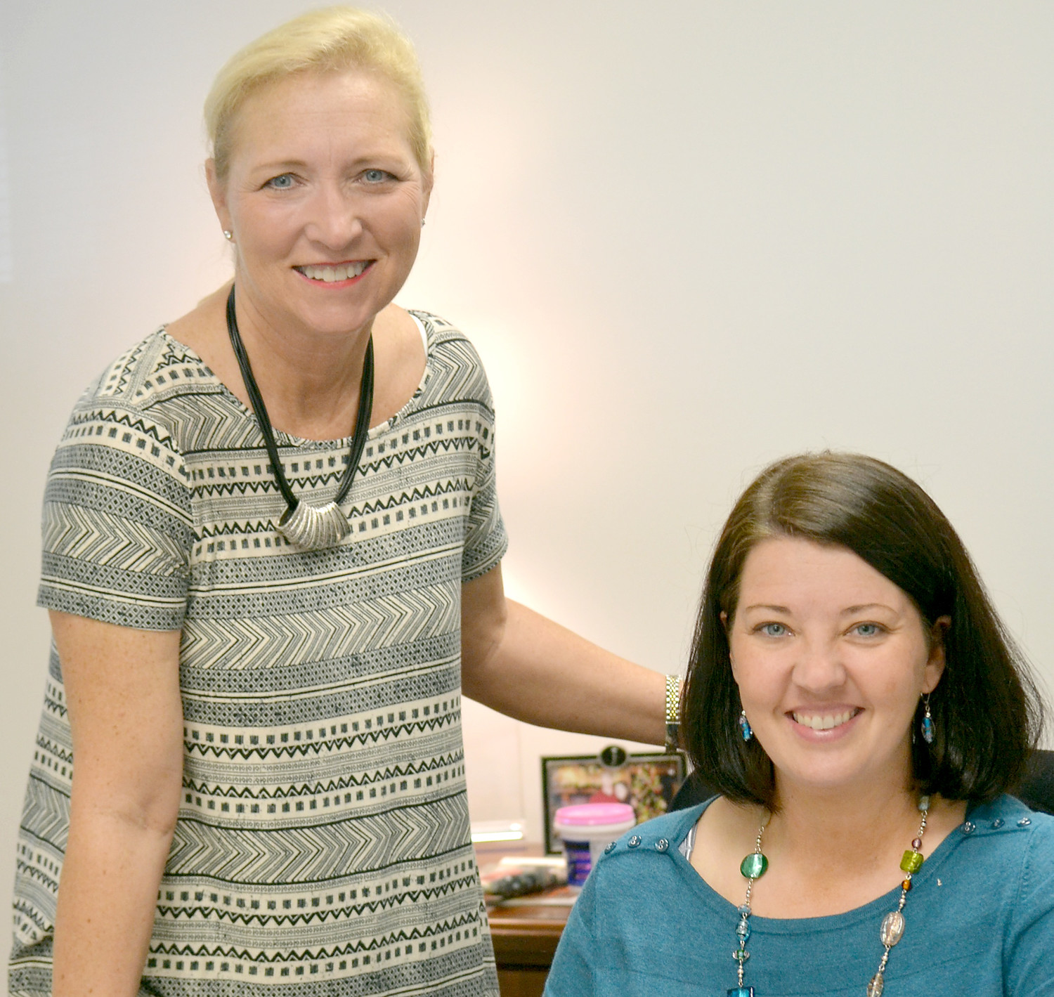JENNIFER PENNELL-ASLINGER, seated, is the new Junior Achievement of the Ocoee Region president. She's pictured with part-time employee Melissa Gunnell.