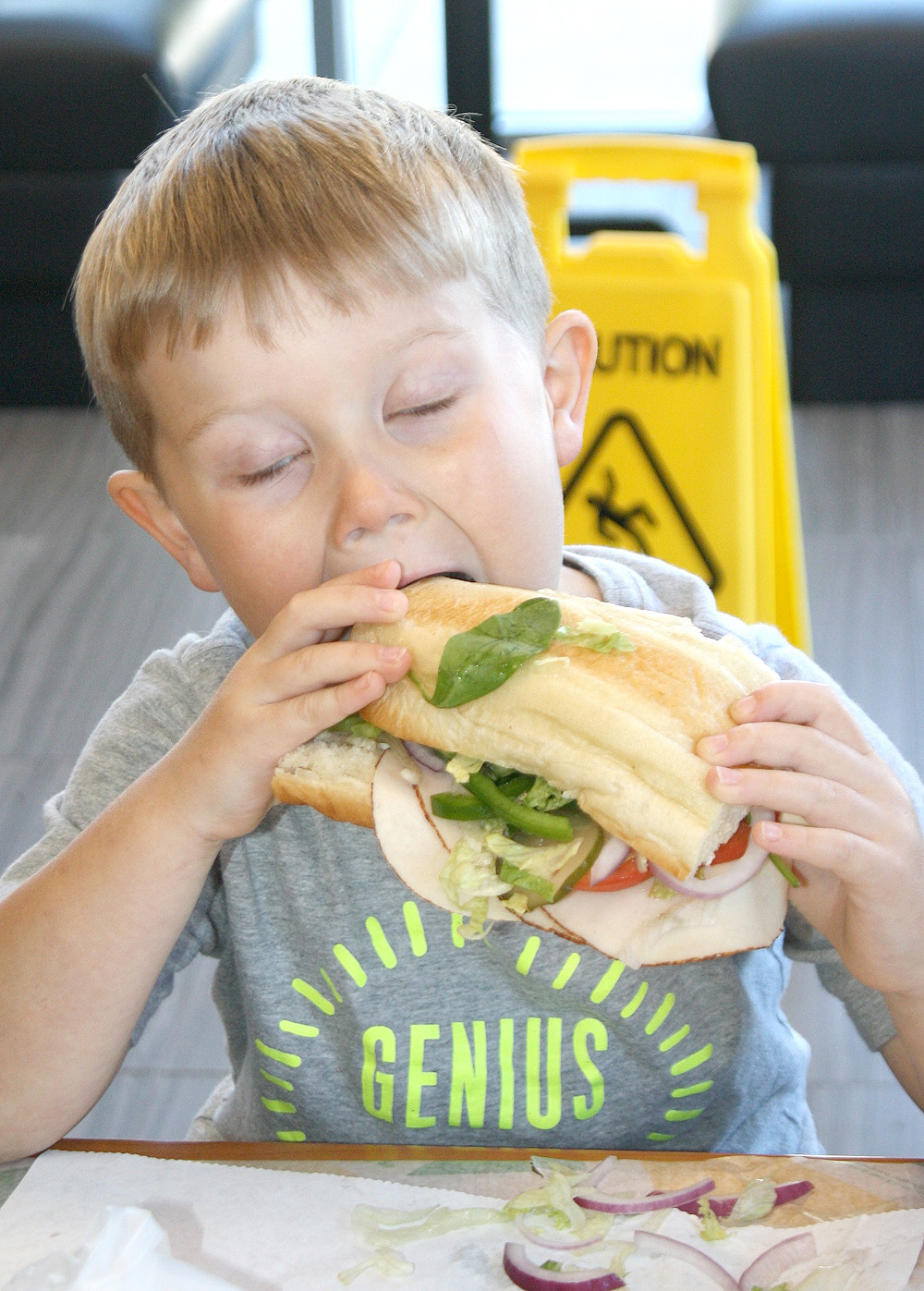 OWEN CULBERSON closed his eyes as he attempted to bite down on a huge Subway sandwich he built himself Monday in the restaurant chain's World Food Day promotion.