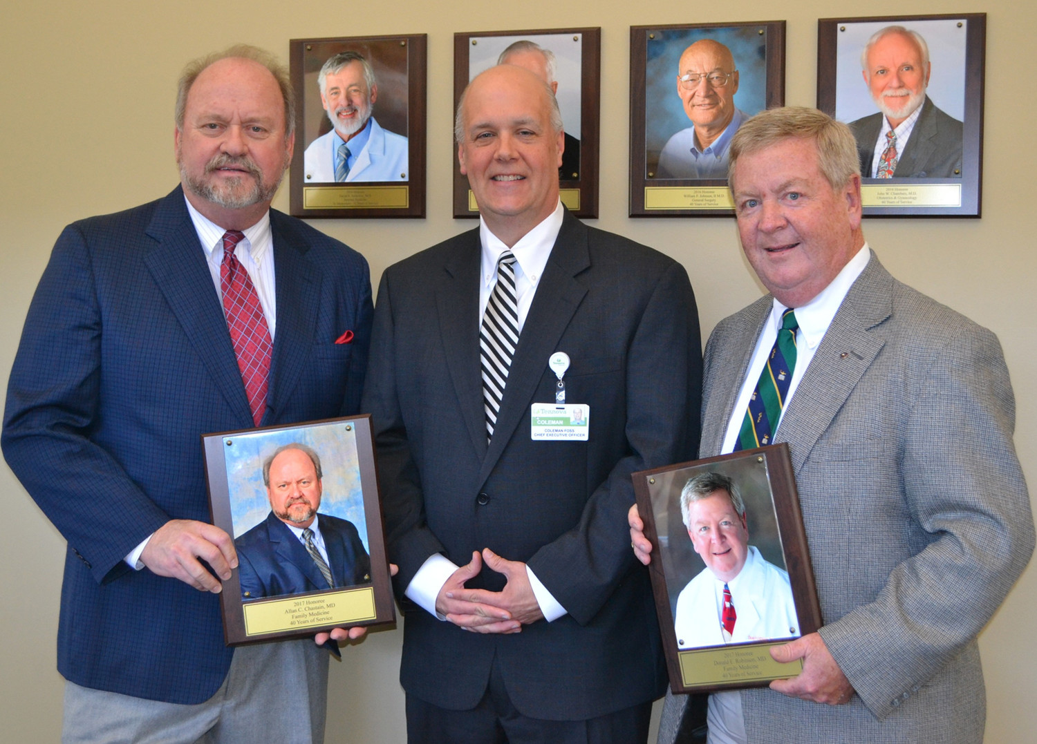 TENNOVA-HEALTHCARE CLEVELAND CEO Coleman Foss, center, presented photographs to both Dr. Allan Chastain, left, and Dr. Don Robinson, to be placed on the hospital's Wall of Honor for the 40-plus year hospital veterans.