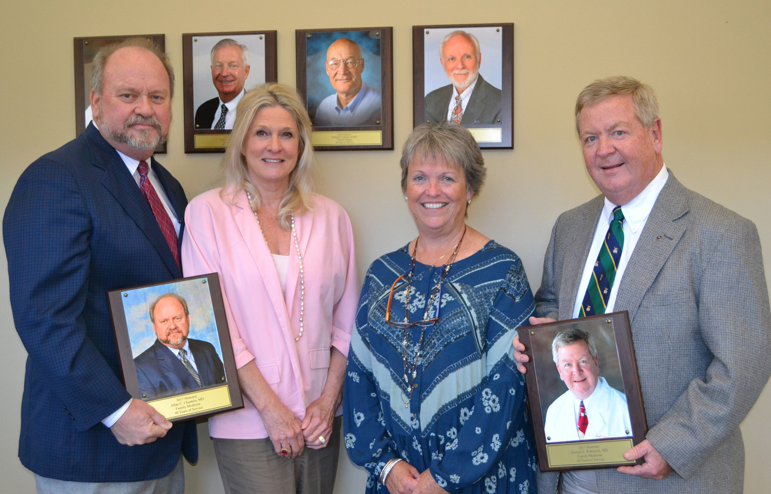 DRS. Allan Chastain, far left, and Don Robinson, far right, were joined at a ceremony Wednesday honoring the two physicians for over 40 years of service to Tennova Healthcare-Cleveland (and its earlier incarnations). They were joined by their wives, Jeanie Chastain and Dawn Robinson.