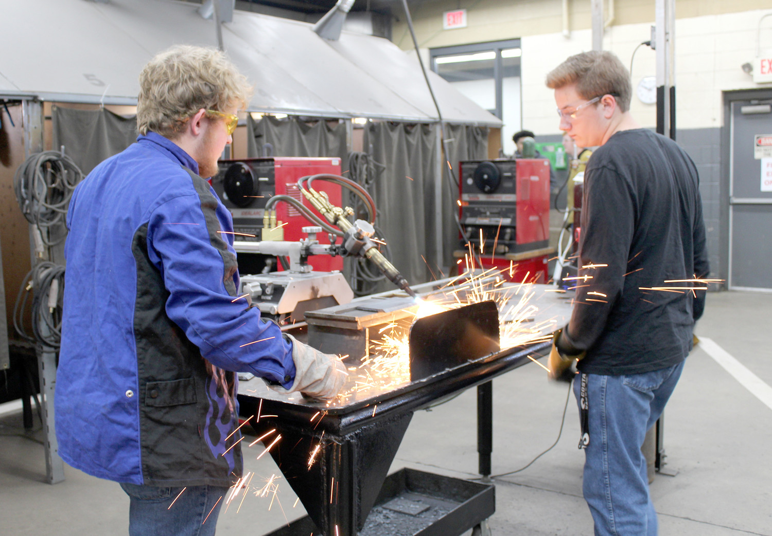 STUDENTS Chandler Kelley, left, and Rob Merritt work on a project in welding class at Bradley Central High School. The class presented a welding project to Whirlpool while paired with the company for Manufacturing Week.