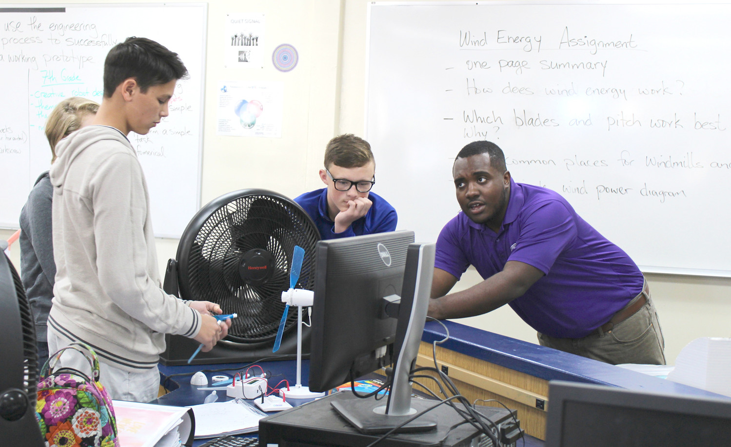 OMARI SMITH, a graduate student at Tennessee Tech University, helps Ocoee Middle School students with a wind power project. A similar project was made available to students at the Cleveland and Lake Forest middle schools.