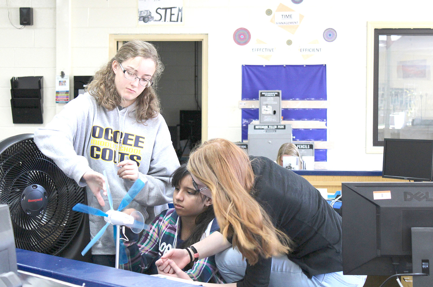 CONCENTRATING on their next steps, Ocoee Middle School students work on a miniature wind turbine as part of an activity led by a representative of Tennessee Tech University's Makers on the Move program.