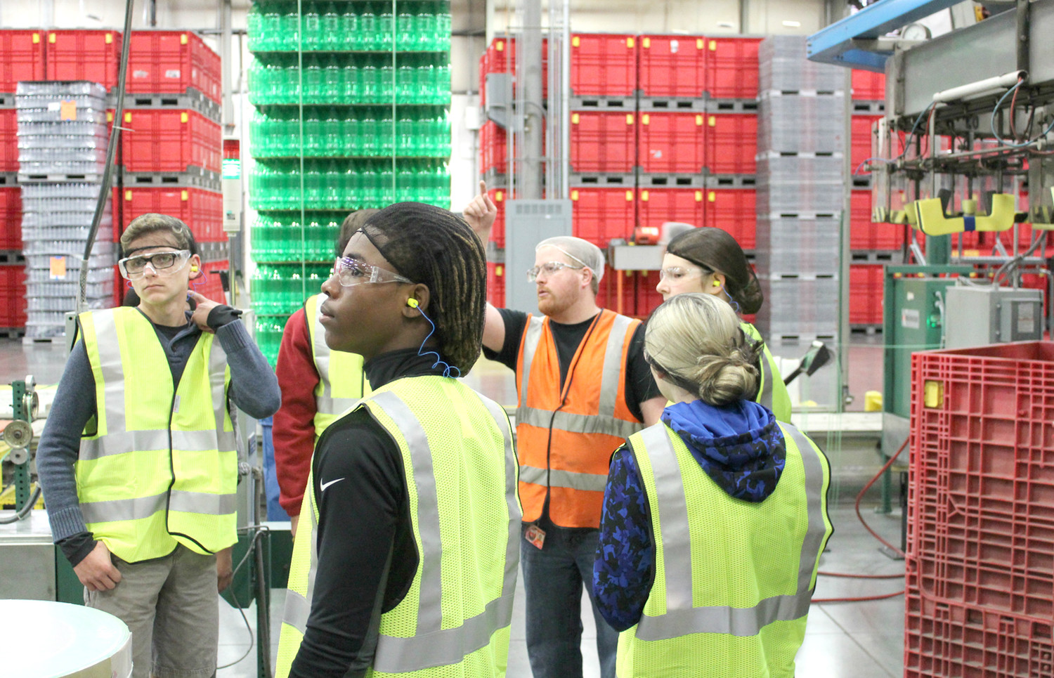 CLEVELAND HIGH SCHOOL students participate in a tour Friday at Southeastern Container, which makes plastic bottles as a supplier for Coca-Cola. Their tour was part of Cleveland Associated Industries' Manufacturing Week.