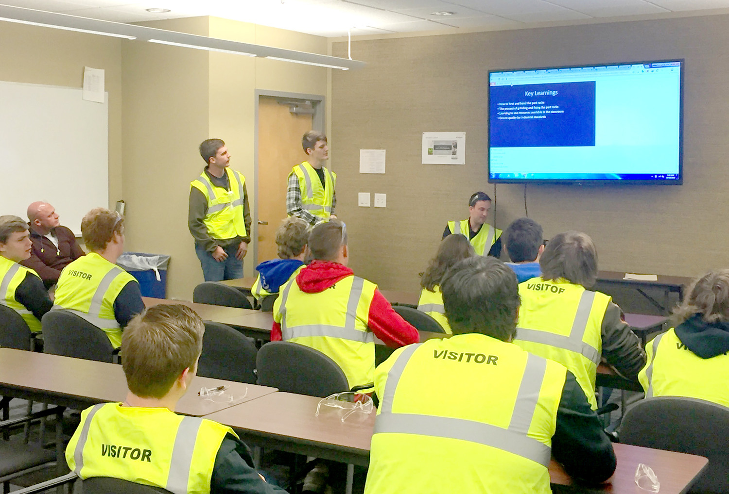 STUDENTS from Bradley Central High School present the results of a welding project to representatives of Whirlpool while visiting the company's Cleveland facility.