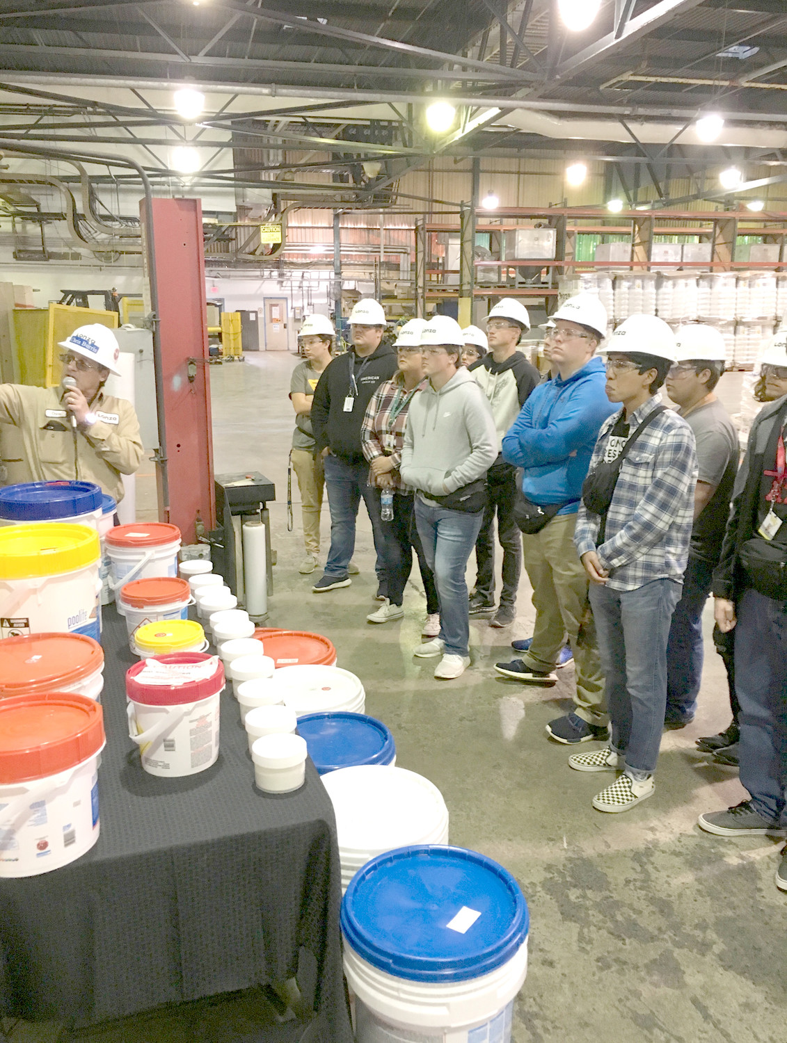 A TOUR GUIDE teaches Walker Valley High School students about the products Lonza makes, during their Manufacturing Week tour on Friday.