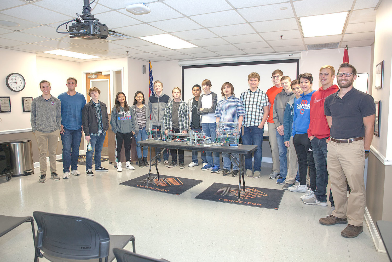 THE CLEVELAND HIGH SCHOOL engineering students and teacher Ben Williams pose for a group photo before embarking on their tour of the Cormetech facility on Friday.
