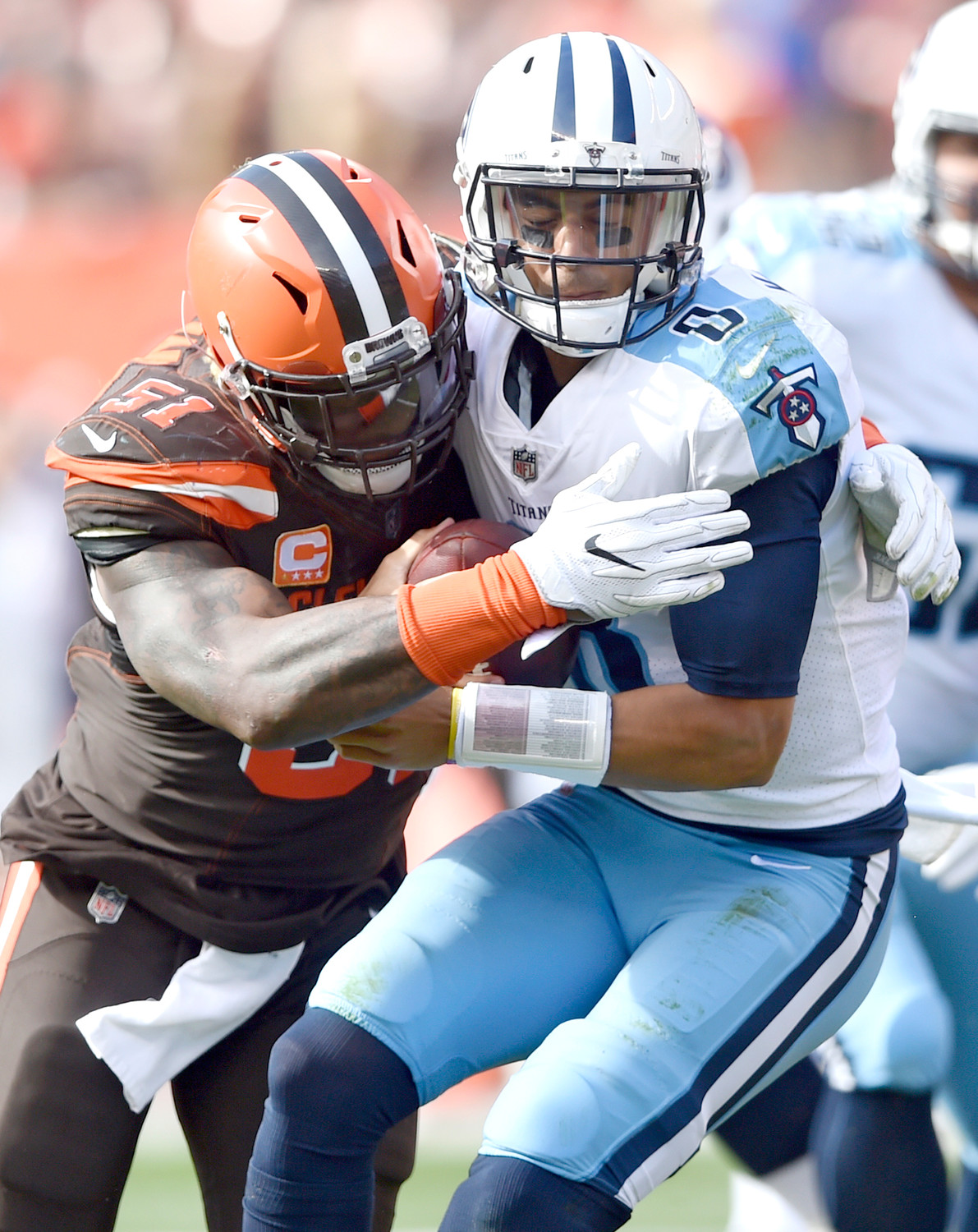 Cleveland Browns outside linebacker Jamie Collins (51) sacks Tennessee Titans quarterback Marcus Mariota (8) in the first half Sunday, in Cleveland.