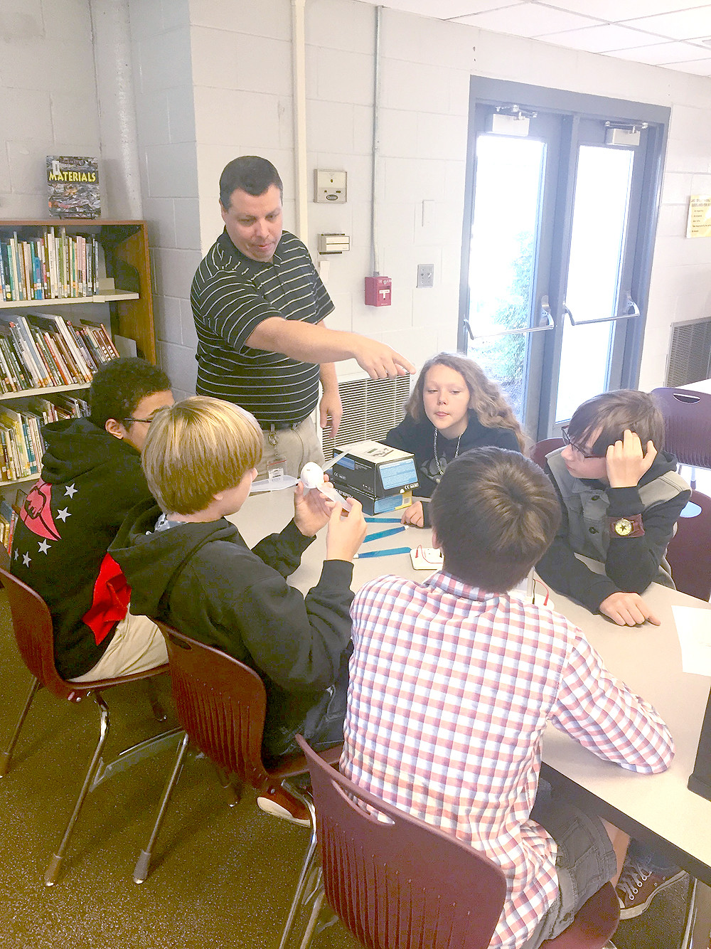 LAKE FOREST MIDDLE students participate in a wind power activity under the direction of teacher Jason Viviano. Tennessee Tech University's Makers on the Move program provided this activity to students during Manufacturing Week.