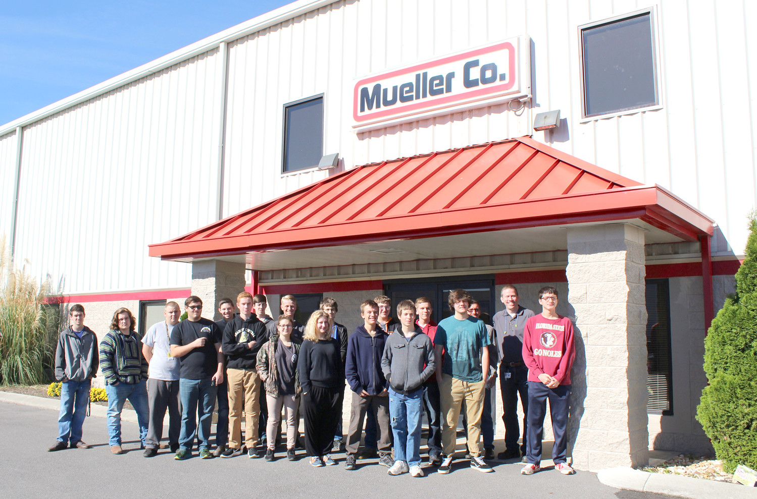 STUDENTS from Shawn Williams' class at Bradley Central High School gather for a photo after touring Mueller Co. The class and the company were paired up for Cleveland Associated Industries' Manufacturing Week.