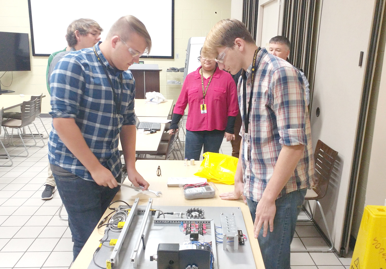 MECHATRONICS students from Bradley Central High School troubleshoot a problem while presenting their project to Bayer. They visited the company as part of Cleveland Associated Industries' Manufacturing Week.