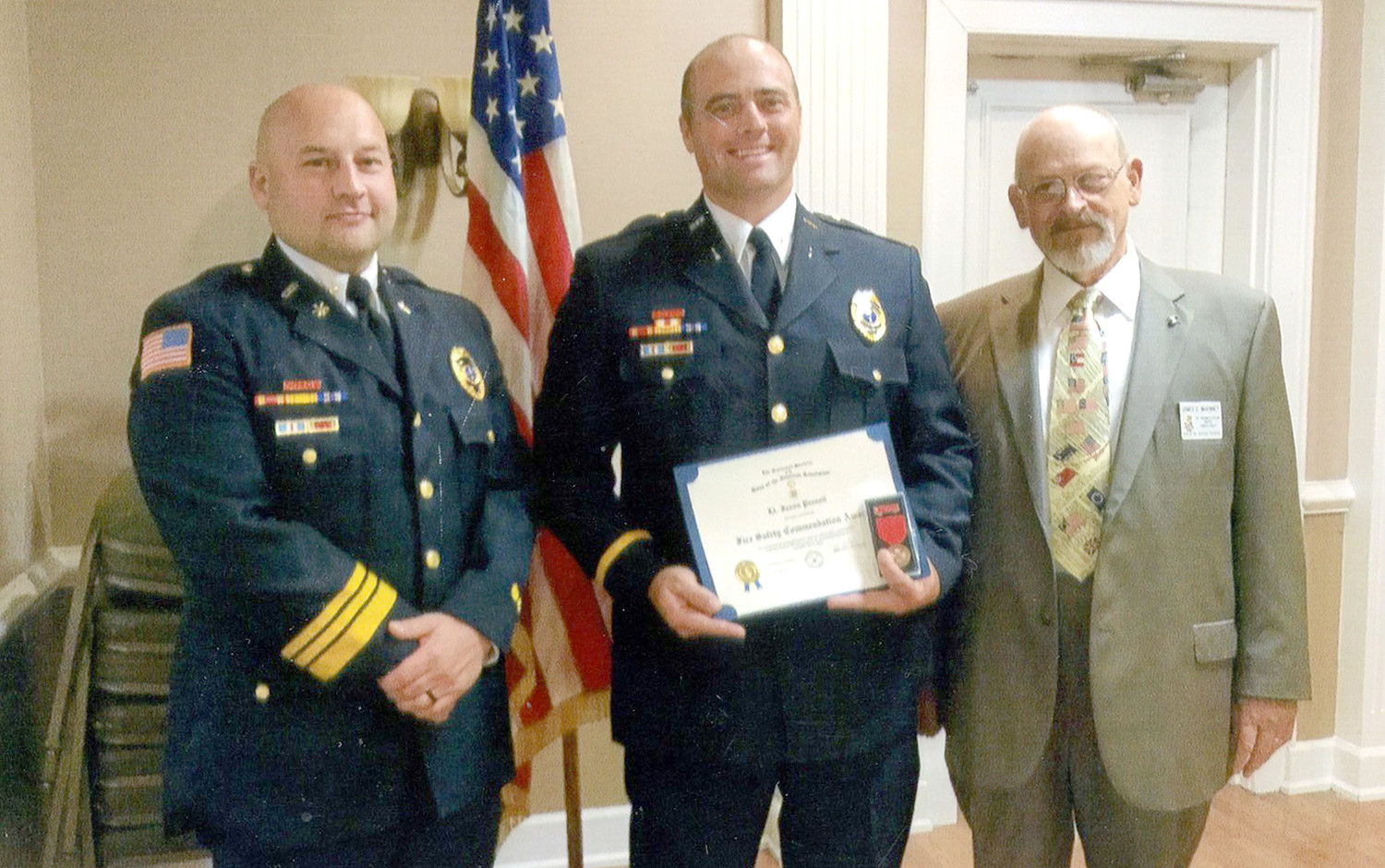 LT. JASON PENNELL, center, was recipient of the Col. Benjamin Cleveland Chapter of the Sons of the American Revolution Law Enforcement Commendation.  A member of the Cleveland Fire Department, Pennell was presented the award by Battalion Chief Josh Ensley and First Vice President Jim McKinney.