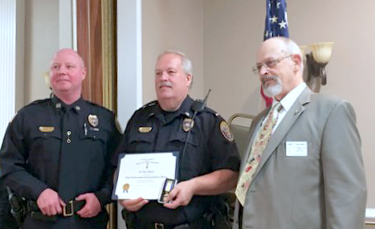 LT. KEN HIGDON, center, was recipient of the Col. Benjamin Cleveland Chapter of the Sons of the American Revolution Law Enforcement Commendation.  A member of the Cleveland Police Department, Higdon was presented the award by Capt. Stacy Smith and First Vice President Jim McKinney.