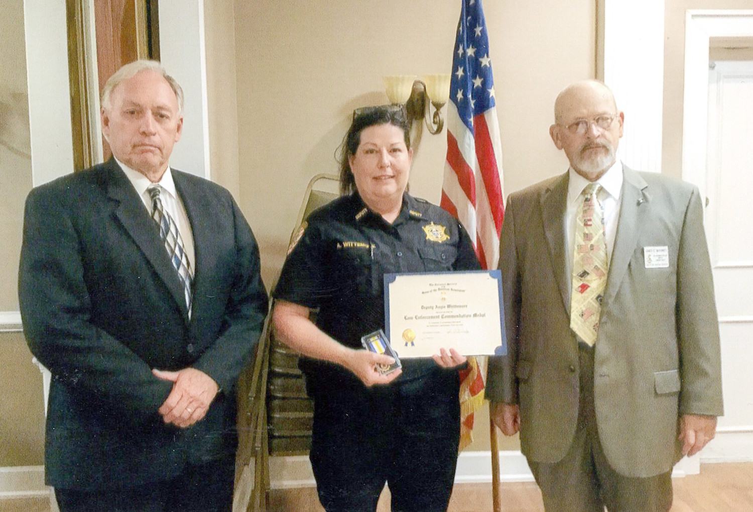 DEPUTY ANGIE WHITTEMORE, center, was recipient of the Col. Benjamin Cleveland Chapter of the Sons of the American Revolution Law Enforcement Commendation.  A member of the Bradley County Sheriff's Office, Whittemore  was presented the award by Dennis Goins and First Vice President Jim McKinney.