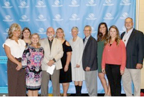 Benton Boys and Girls Club/Ocoee Youth Center Board of Directors pose with the Rev. Wayne Dickert, speaker. From left are Kelley Morgan; Christal Morris; Dana Teasley; Al Pierce; Elaine Phillips; Meg Lemons; e Dickert; Holly Stroud, unit director; Rachel Lowe; and John Miles.