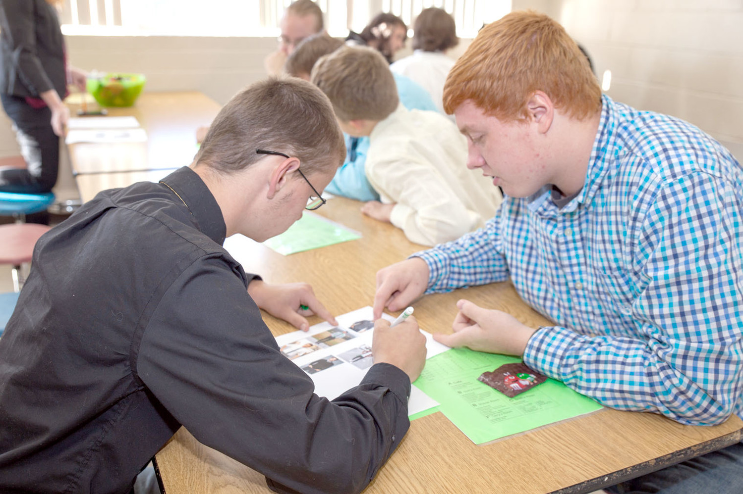 GOAL ACADEMY STUDENTS Mason Roberts, left, and Dylan Psyhos participate in an activity to identify things to avoid wearing to an interview.
