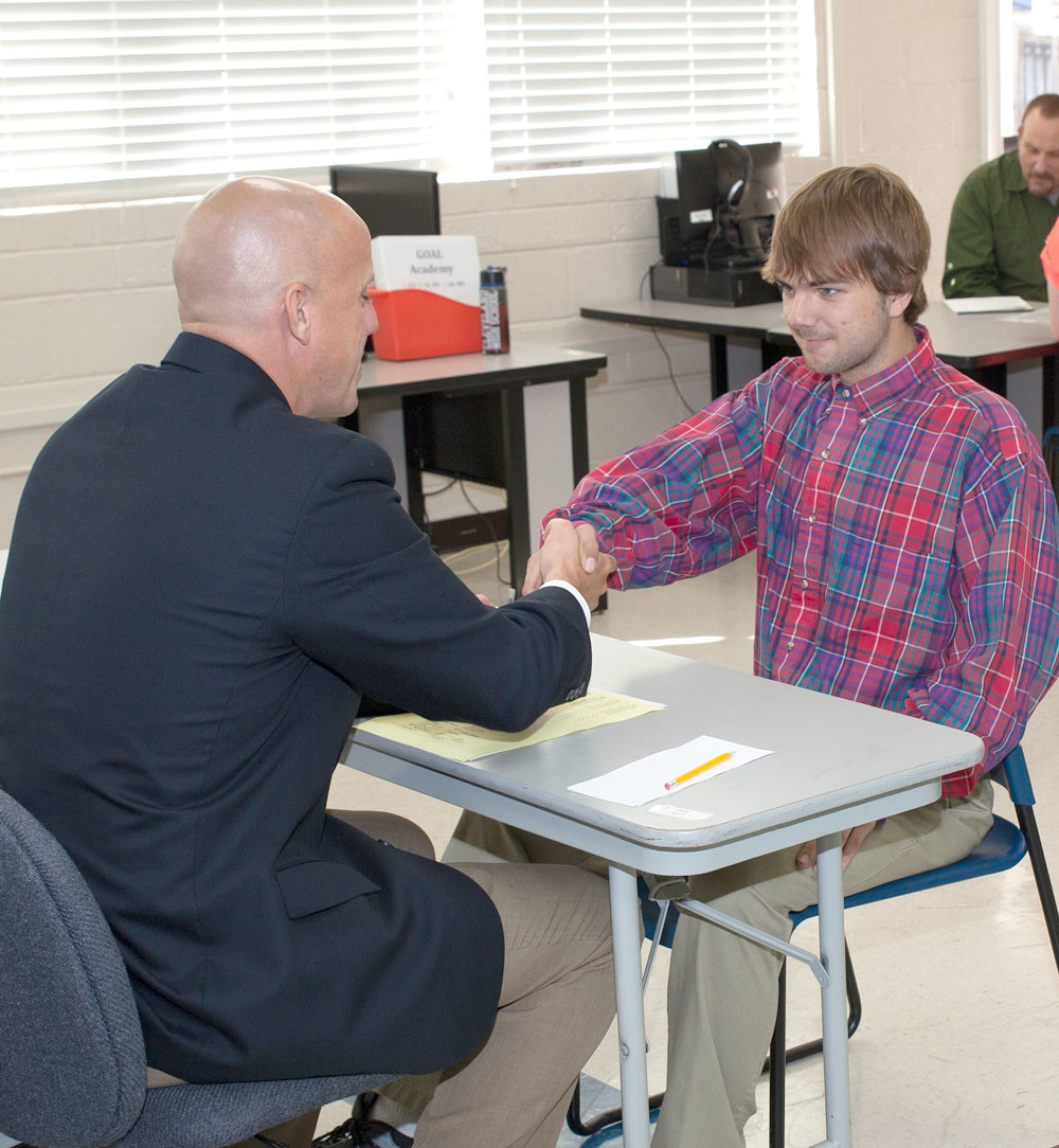 GOAL ACADEMY STUDENT Jax Hicks, right, begins his interview with Steven Shelton using a firm and confident handshake.