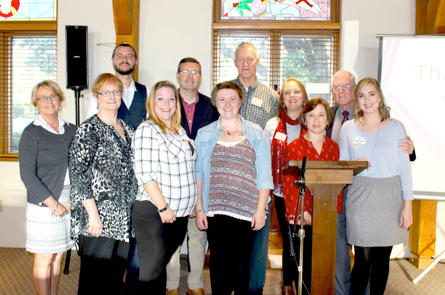 FOUNDATION HOUSE MINISTRIES staff, board members and supporters gather for a photo with two of the maternity home's current residents after its latest fundraising breakfast. They are Kayla Jones, third from left in the front row, and Laura Ramsey, to her right.