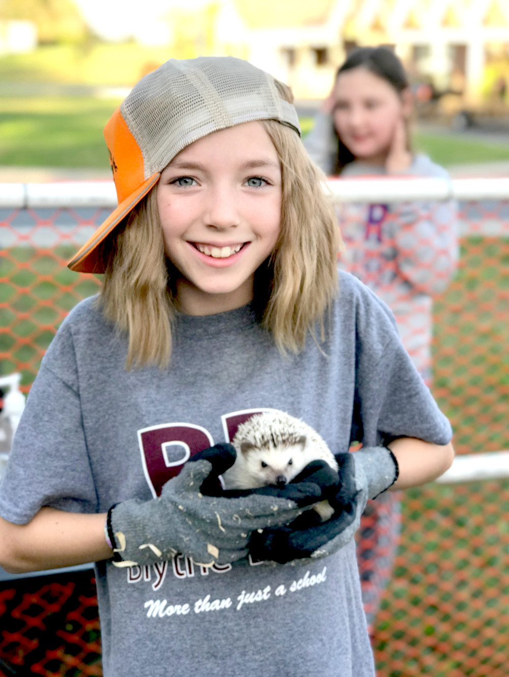 CLAIRE PHILLIPS holds one of the hedgehogs from the Little Country Farm and Petting Zoo, at the fall festival held at Blythe-Bower Elementary School.