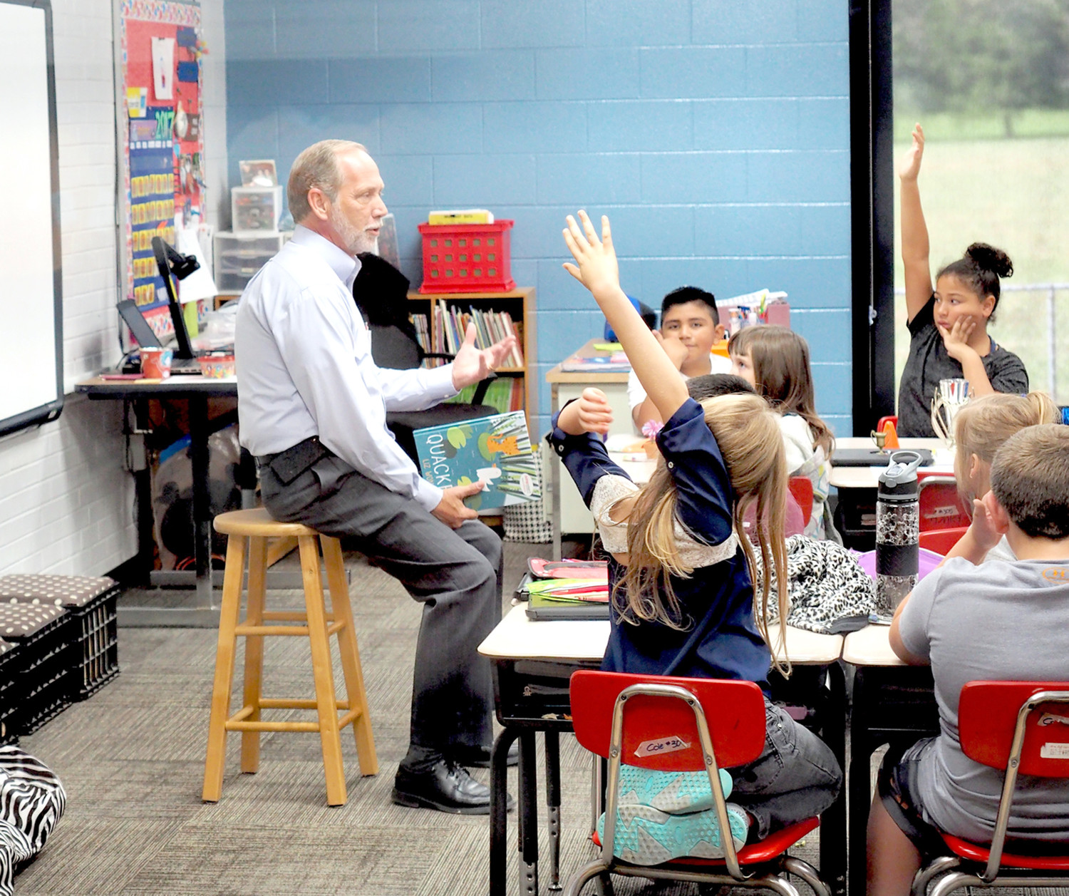 COUNTY MAYOR D. Gary Davis talks to third-graders in Jenny Cole's class about citizenship and the role of county government, during Read for the Record.