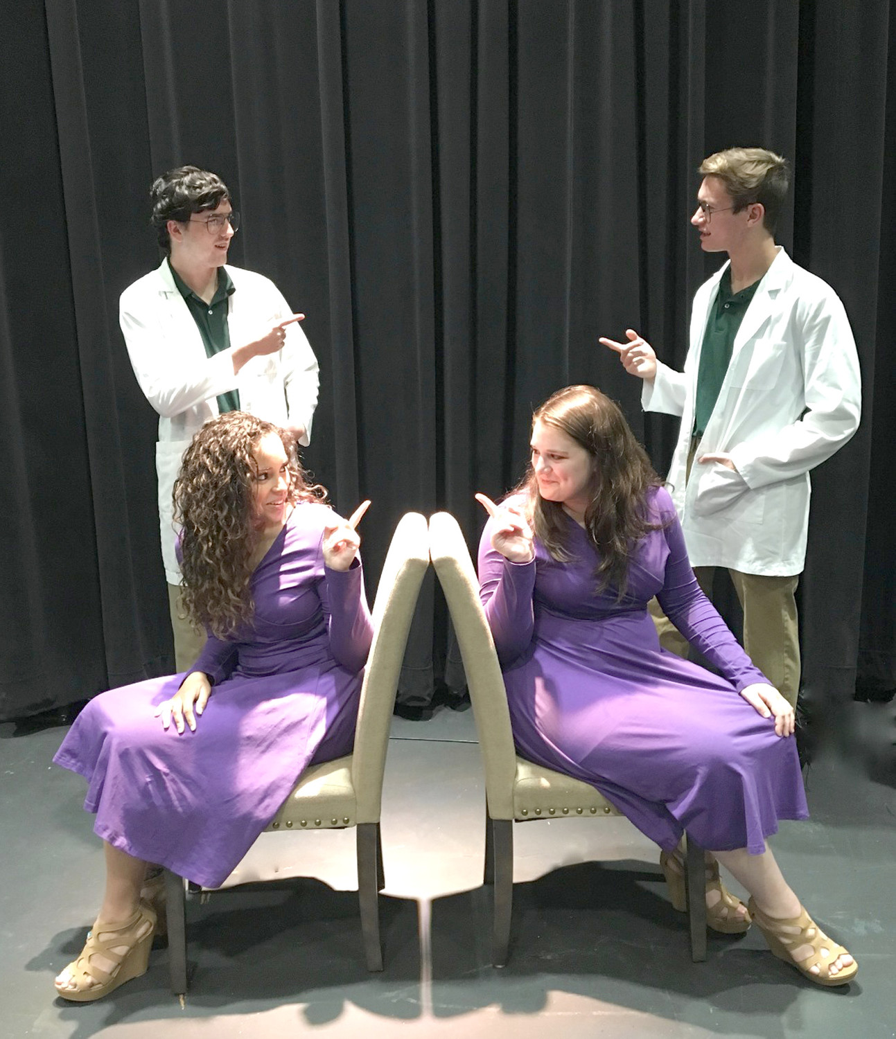 During rehearsal, Lee students Scott Rust, Jake Cash, Hannah Wiggonton, and Gabby McDonald realize they are seeing double in Enigma Variations.
