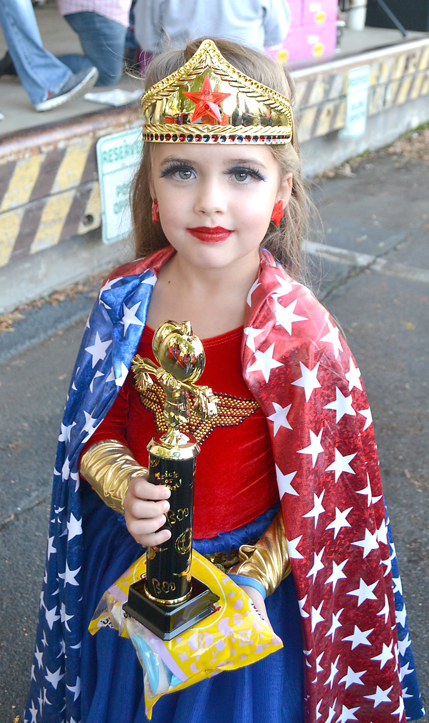 WONDER WOMAN was one of the costume contest winners, receiving a trophy and bag of candy. The contest was sponsored by M&M Mars.