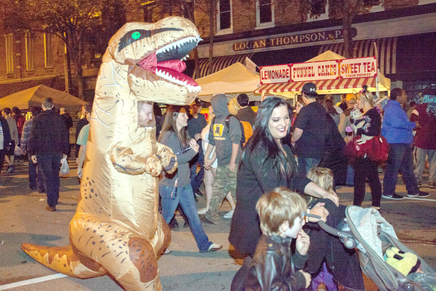 THE HALLOWEEN Block Party welcomed plenty of unique monsters, one of which was this Tyrannosaurus rex.