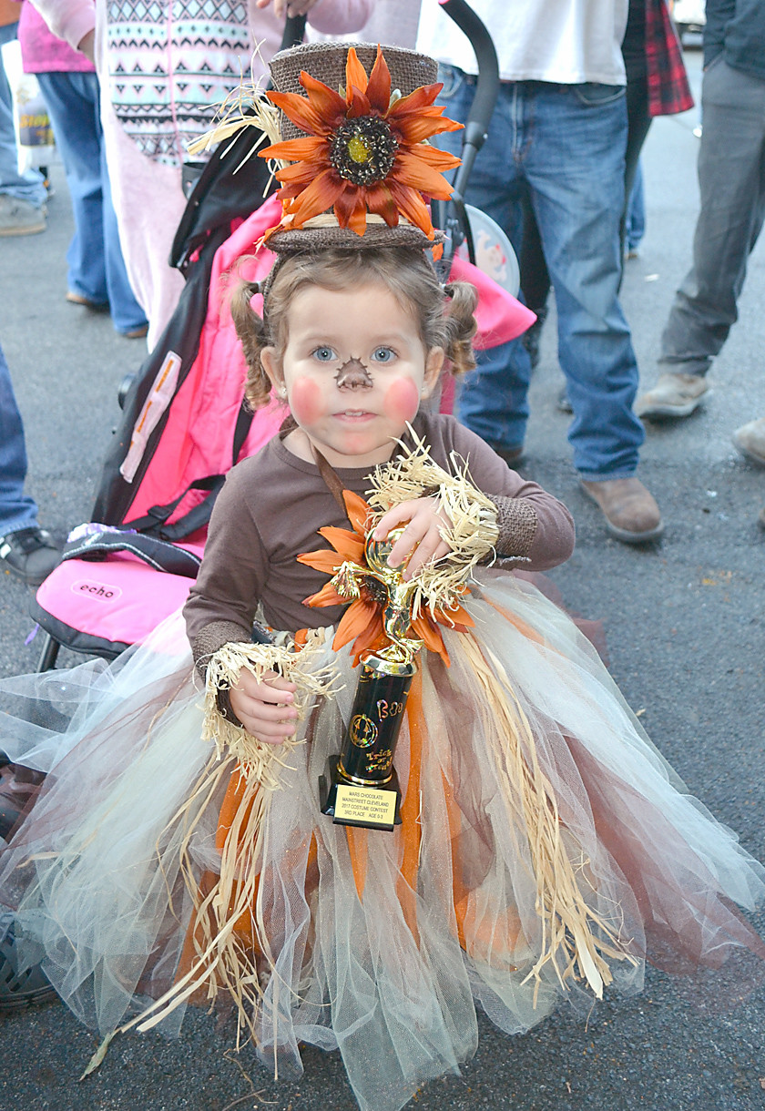 THIS SUNFLOWER PRINCESS was one of the many contest winners at the costume contest Tuesday night.