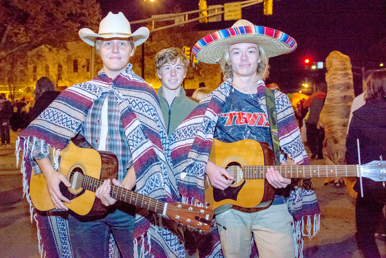 ONE UNIQUE GROUP at the Block Party was this mariachi band.  From left are Jeremiah Rosenbrook, Dakota Whittaker and Patrick McMinn.