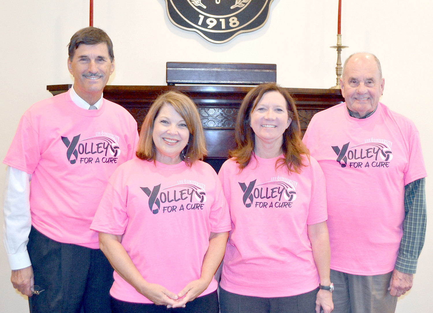 LEE PRESIDENT Dr. Paul Conn and Cleveland Mayor Tom Rowland wear the pink Volley for a Cure shirts. From left are Conn, cancer survivor Stephanie Taylor, Lee volleyball coach Andrea Hudson, and Rowland.