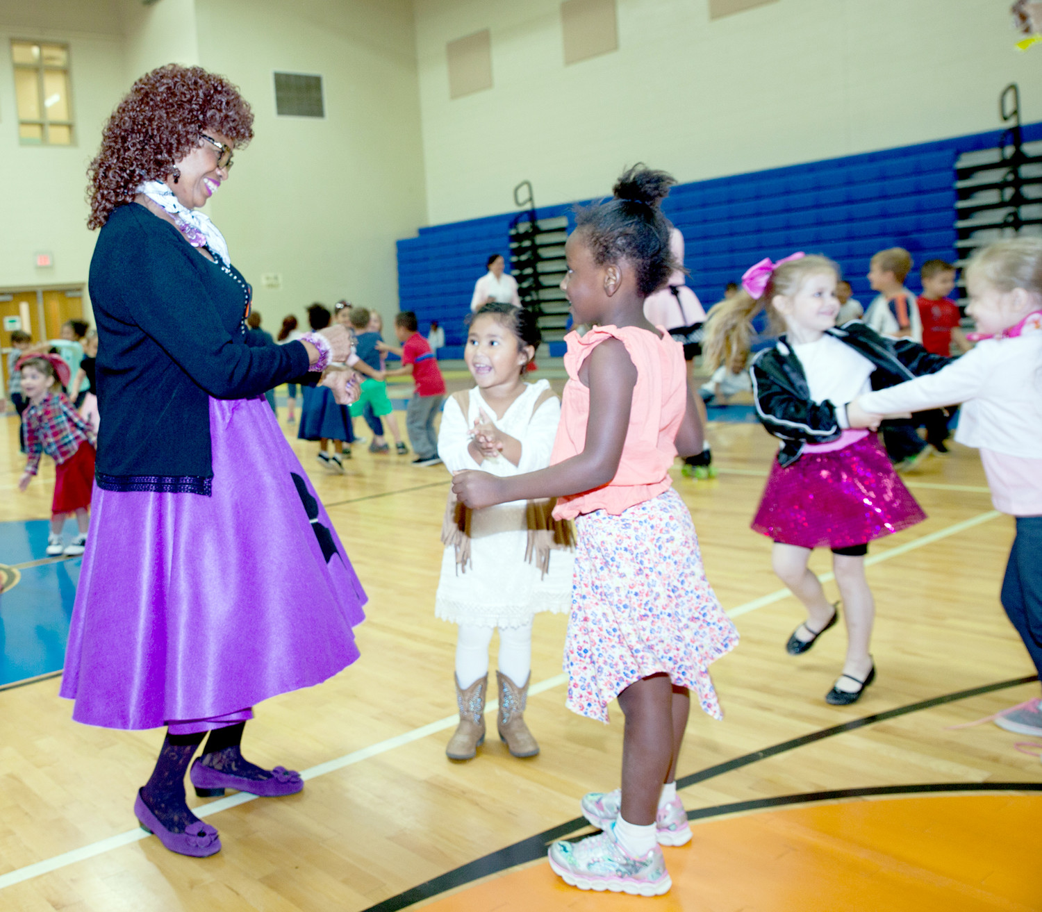 SHARON WINFIELD, left,  shows two students how to twist during the sock hop.