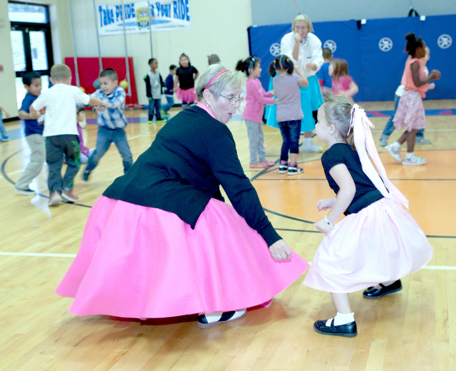 STUDENT SERENITY CARTWRIGHT, right, shows Creddia York that she can match her, move for move, during the sock hop.