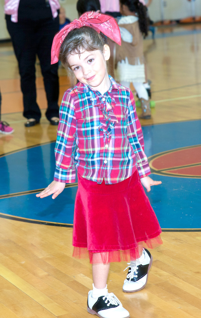 STUDENT KARLITA MATEA poses on the dance floor at Friday's sock hop.