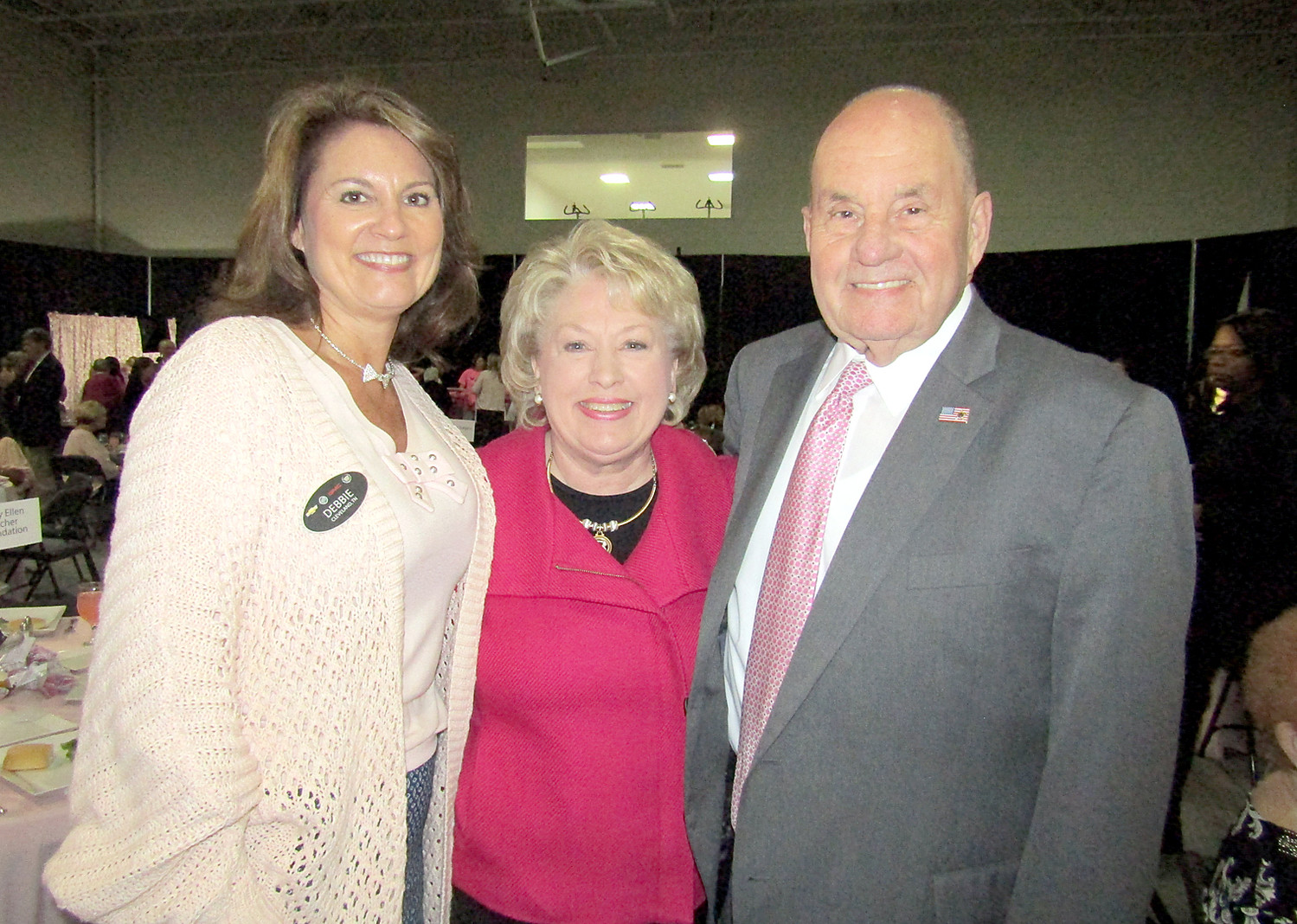 DEBBIE MELTON meets up with Sandra and Mayor Tom Rowland prior to the beginning of the Volley for a Cure luncheon.