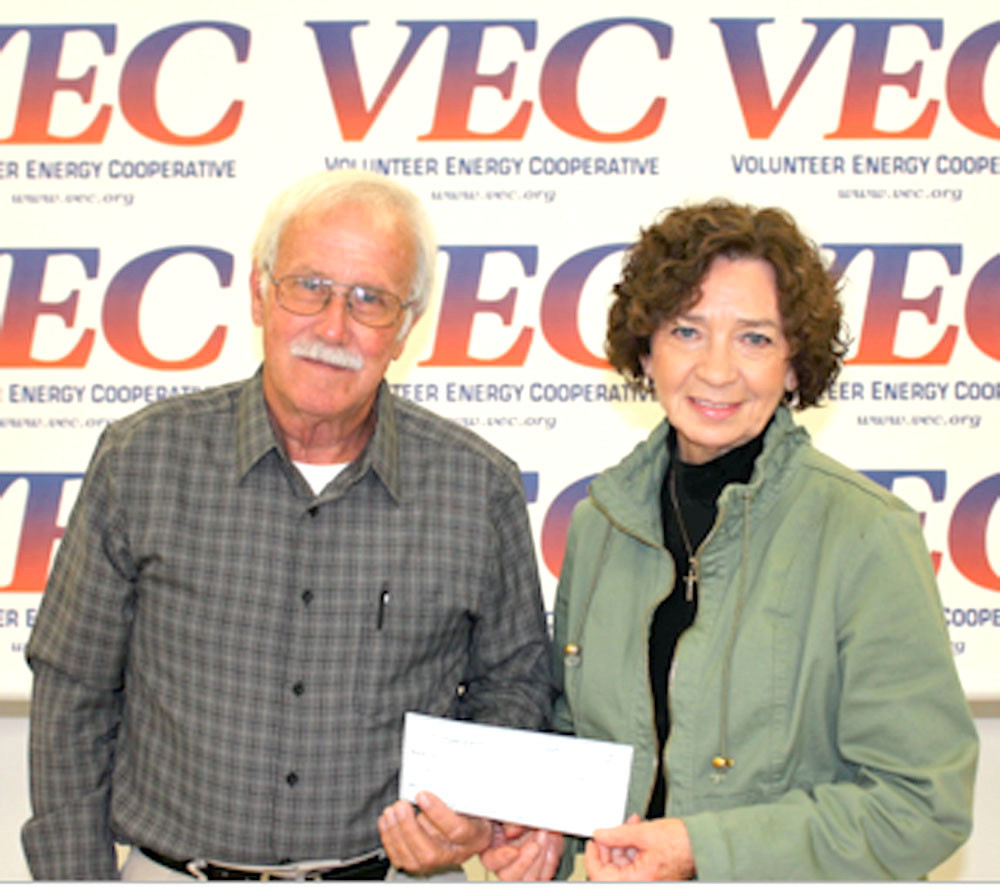 VECustomers Share Board member Dana Burgner, left, presents a grant check to New Life Community Kitchen Manager Karen Cross.
