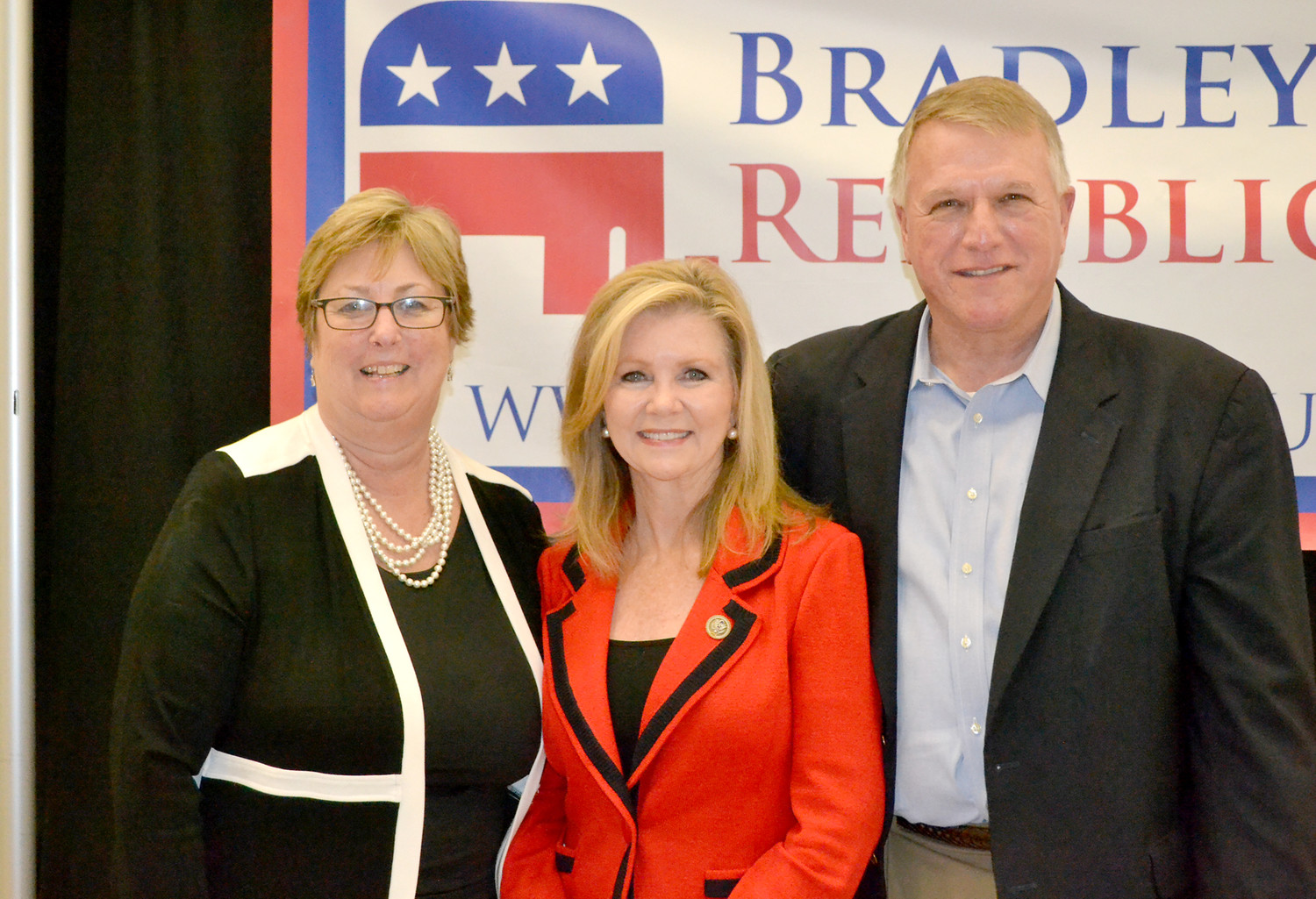 REPUBLICAN CHAIRMAN Richard Burnette and his wife, Malinda, took time following Saturday's Reagan Day Dinner for a photograph with keynote speaker Marsha Blackburn, center.