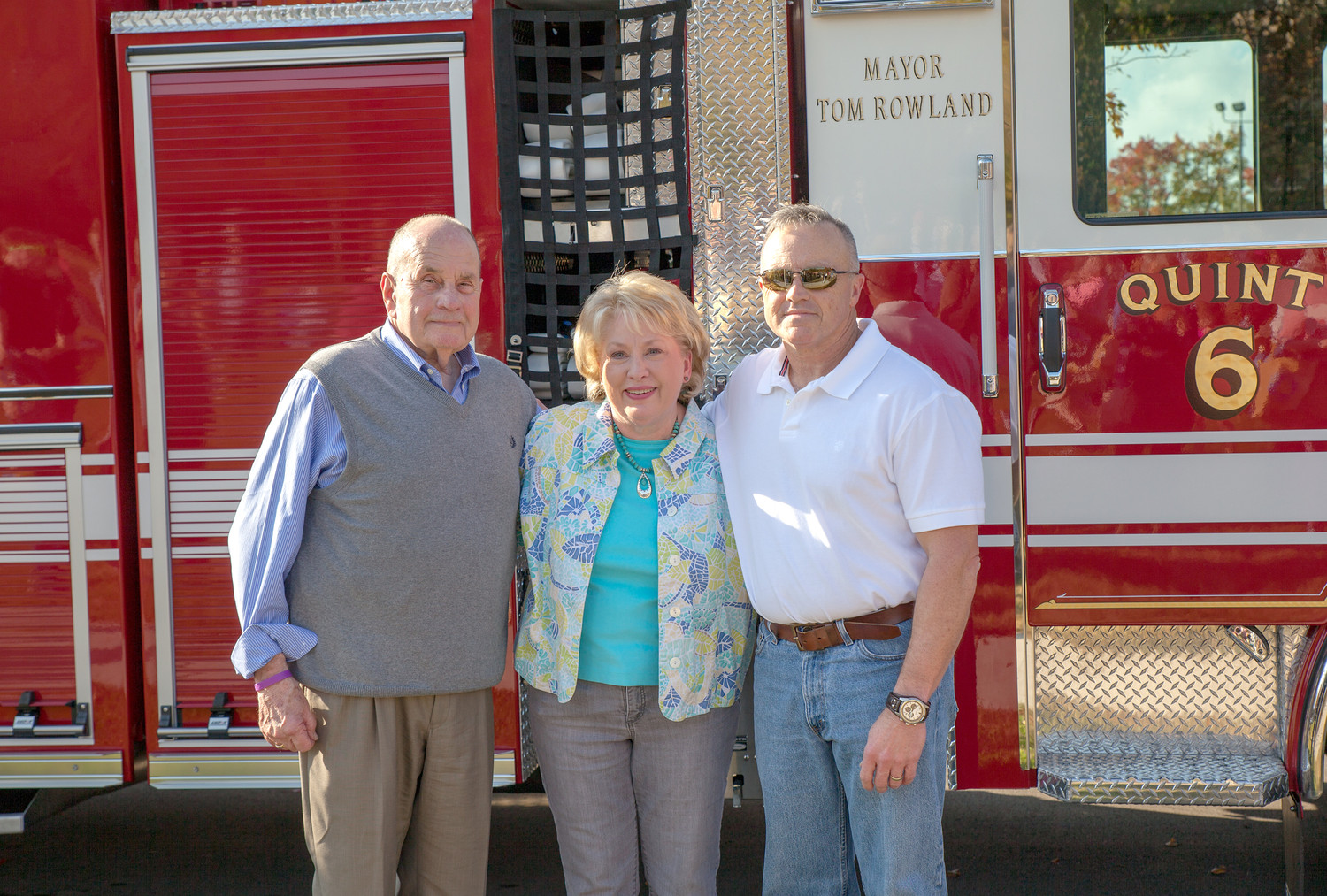MAYOR TOM ROWLAND, left, and his wife, Sandra, were pleasantly surprised when Cleveland Fire Department Chief Ron Harrison, right, made the surprise announcement that the latest addition to the fleet of trucks servicing the Cleveland area was named after the mayor.